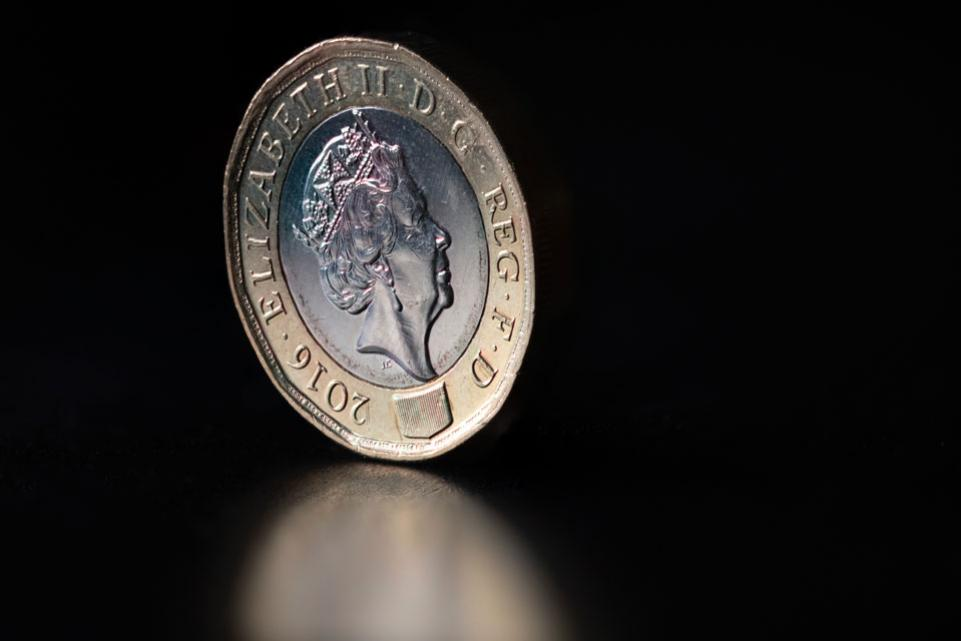 A pound coin on a table